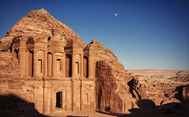 Late afternoon sun colours the sandstone of Al-Deir, the Monastery of Petra.