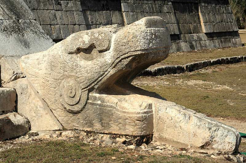El Castillo and the sculpture of a serpent at the base of one of the stairways
